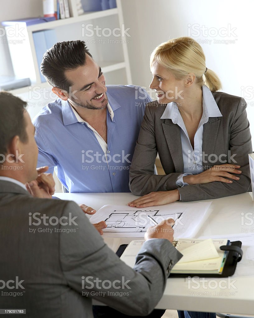 Couple happy to become owner meeting construction planner royalty-free stock photo