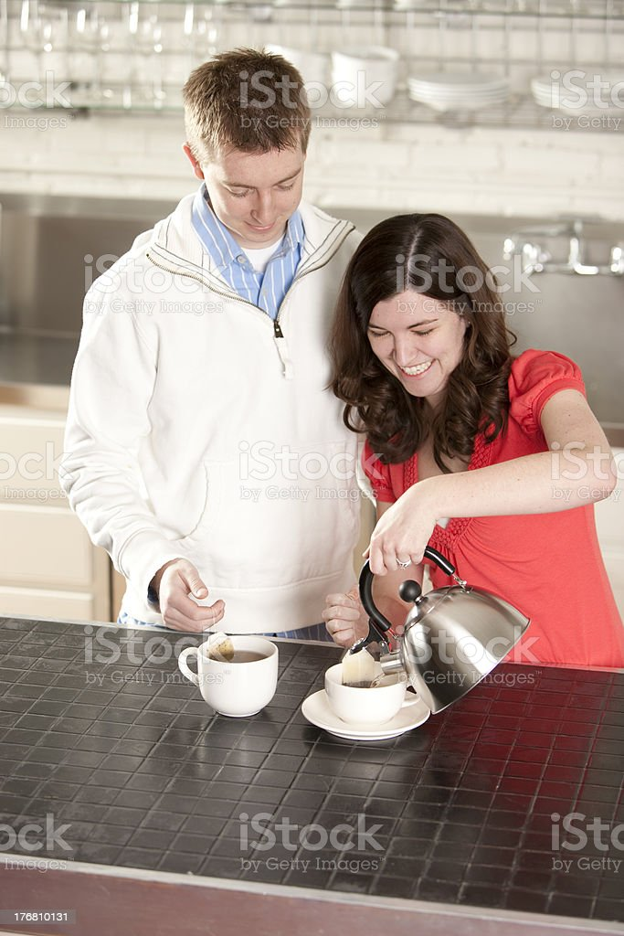 Couple Has a Cup of Tea in the Kitchen royalty-free stock photo