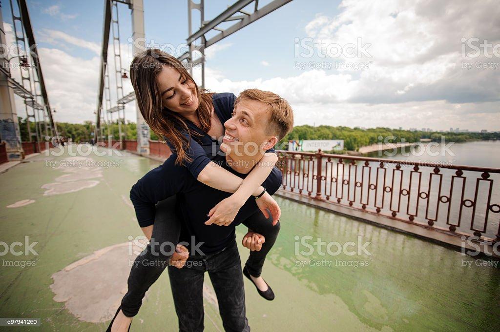 Couple have fun on the bridge foto royalty-free