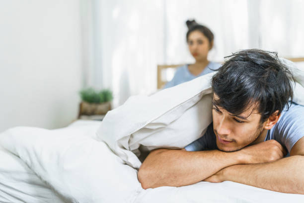 Couple have sex problems on the couch. Lovers unhappy in life partner. Concept of lifestyle and family. stock photo