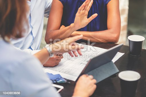 istock Couple having a business meeting with a architect or real estate agent. 1040653656