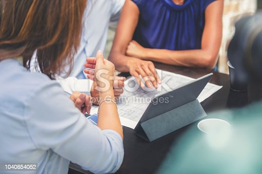istock Couple having a business meeting with a architect or real estate agent. 1040654052