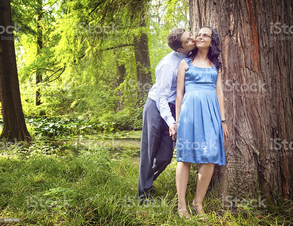 Couple having a candid romantic kiss outdoor royalty-free stock photo