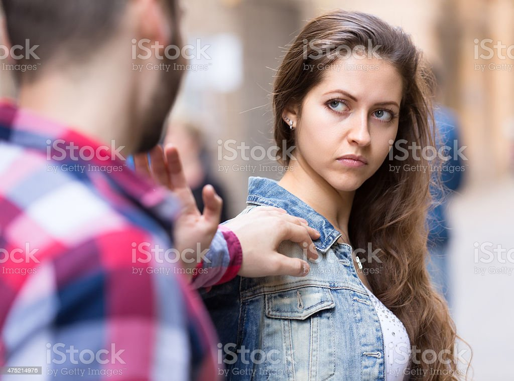 Couple having a conflict on a street stock photo