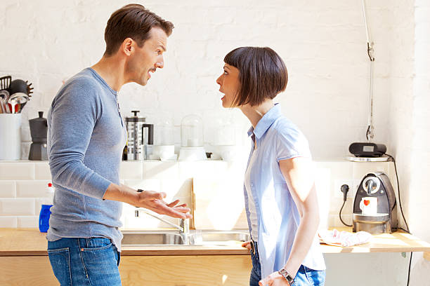 couple having a discussion in the kitchen - fighting stock photos and pictures