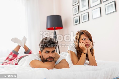 683664728istockphoto Couple having a fight in bedroom 1127567613