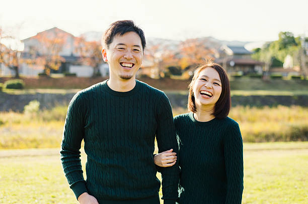 couple having a good time in outdoors - japanischer abstammung stock-fotos und bilder