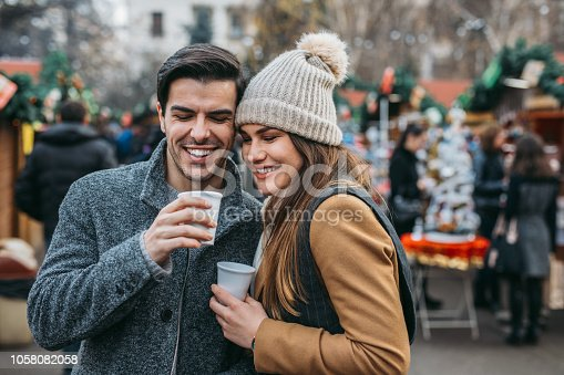 Couple drinking hot wine at the Christmas market.