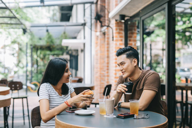 Couple having a lunch in a Cafe stock photo