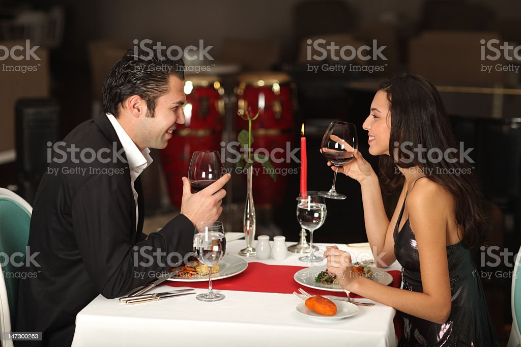 Couple having a romantic candle lit dinner royalty-free stock photo