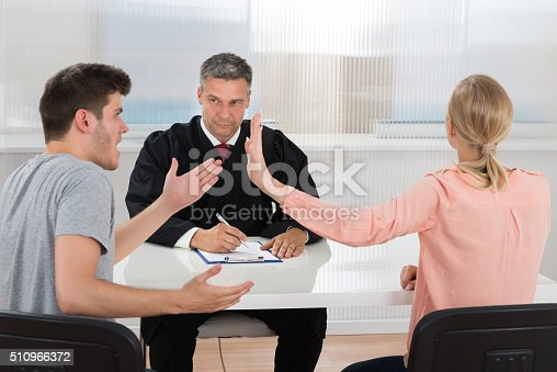 istock Couple Having An Argument In Front Of Judge 510966372