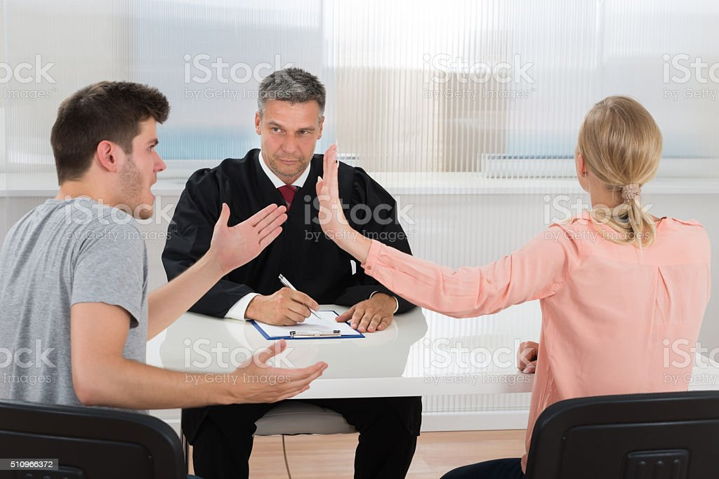 Couple Having An Argument In Front Of Judge stock photo