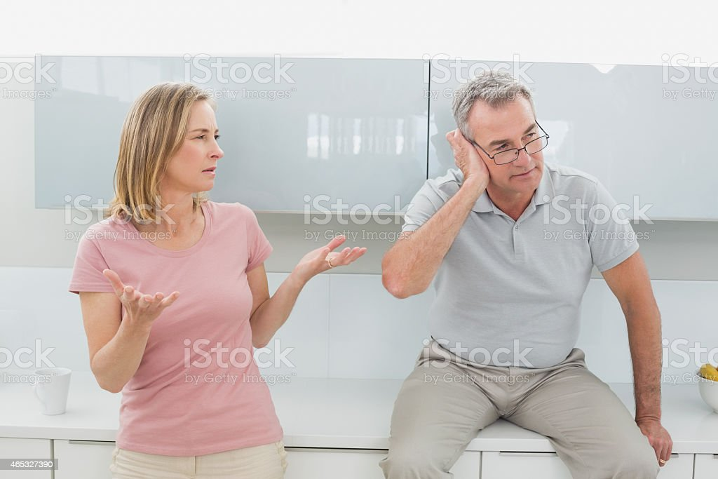 Couple having an argument in kitchen stock photo