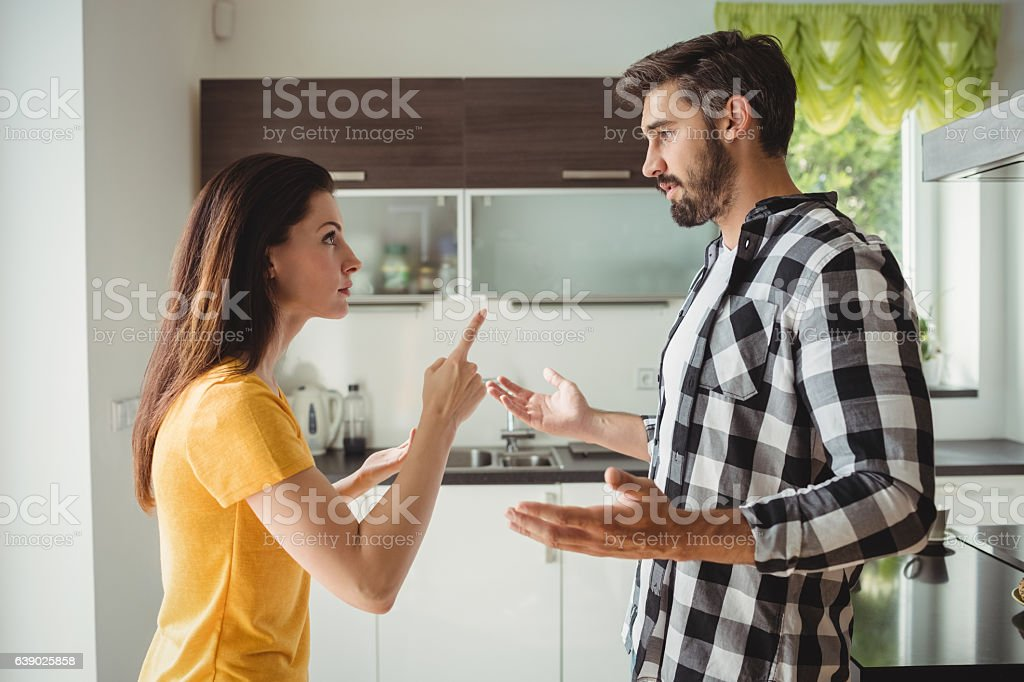 Couple having argument in kitchen stock photo