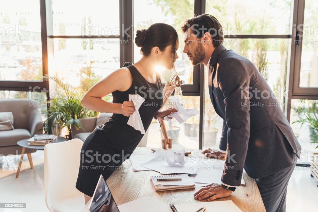 Couple having argument in office stock photo