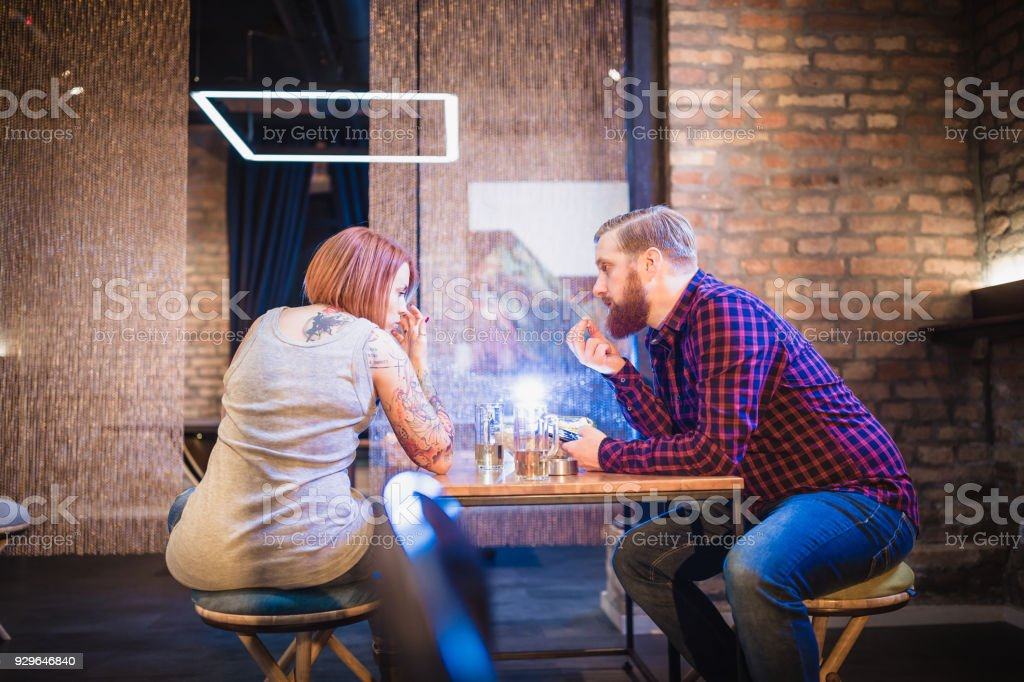 Couple having argument in the night club stock photo