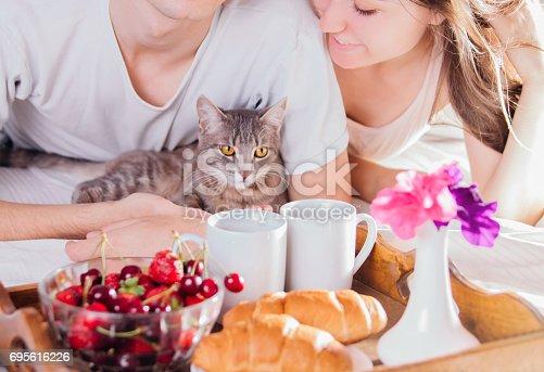 istock Couple having breakfast in bed 695616226