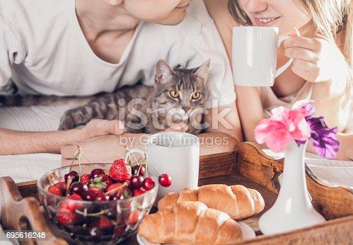 istock Couple having breakfast in bed 695616248