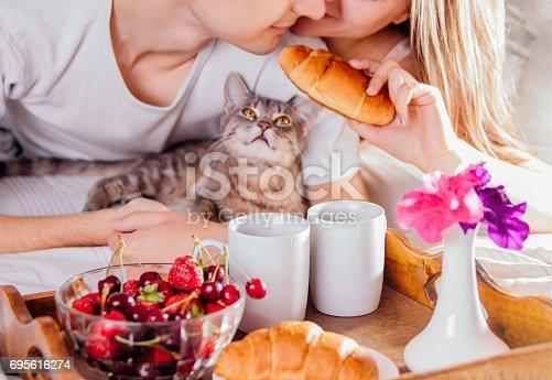 istock Couple having breakfast in bed 695616274