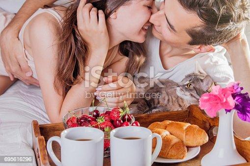 istock Couple having breakfast in bed 695616296