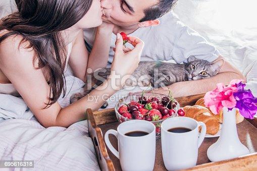 istock Couple having breakfast in bed 695616318