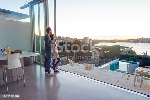 istock Couple having breakfast together at home. 602294990