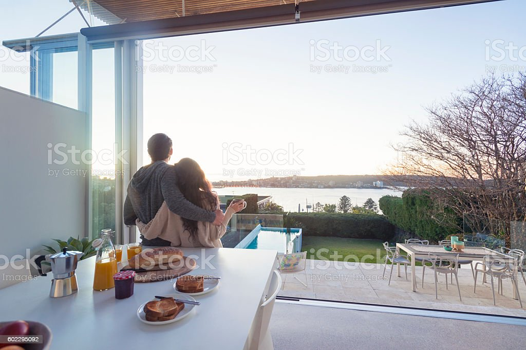Couple having breakfast together at home. stock photo