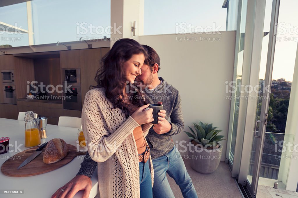 Couple having breakfast together at home.