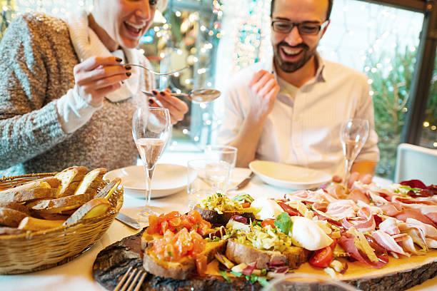 Couple having Christmas dinner in a restaurant stock photo