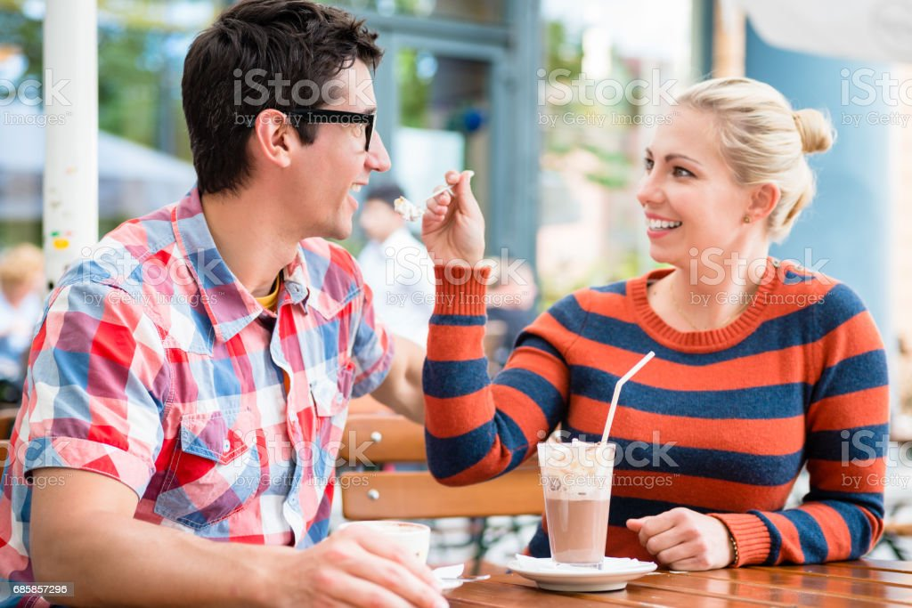 Couple having coffee in a street cafe stock photo