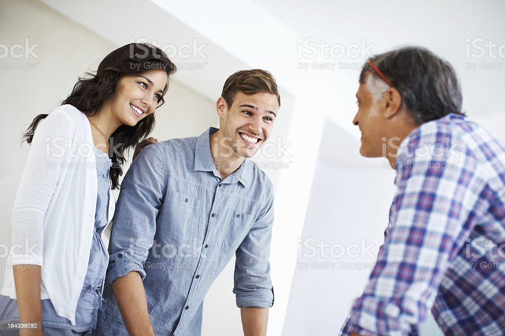 Couple having conversation with architect royalty-free stock photo