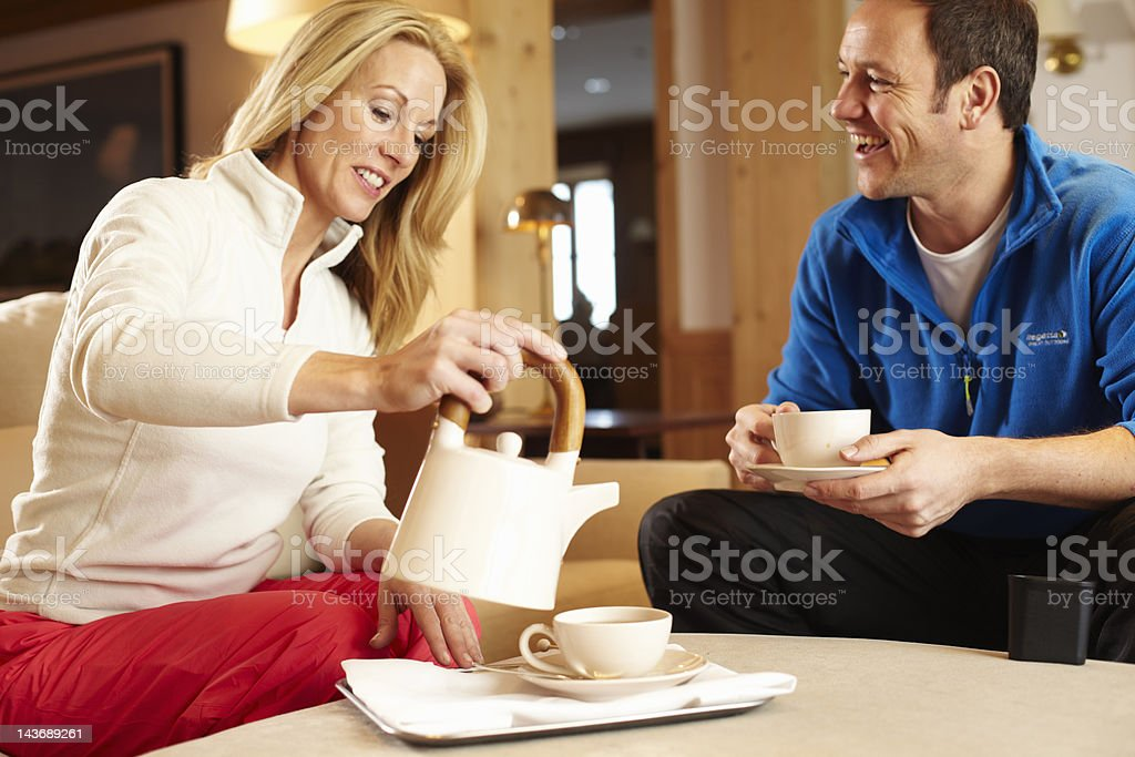 Couple having cup of tea together royalty-free stock photo