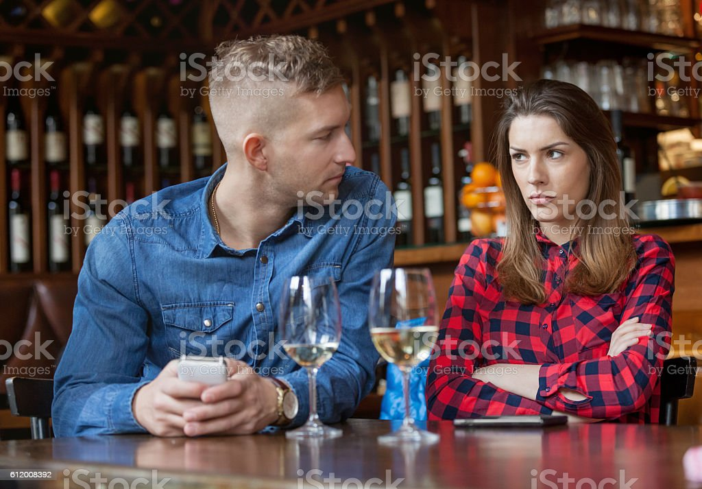 Couple having disagreement in caffe stock photo