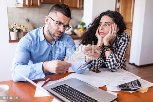 istock Couple having financial problems 894101282