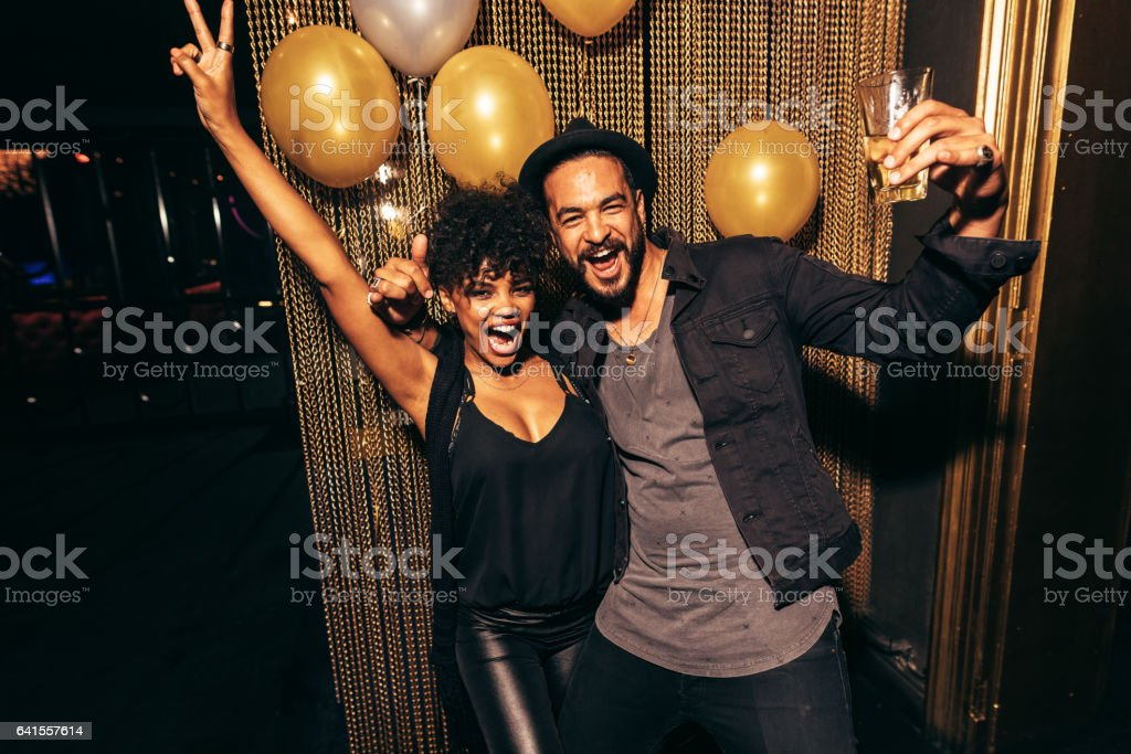 Couple having fun at disco party stock photo