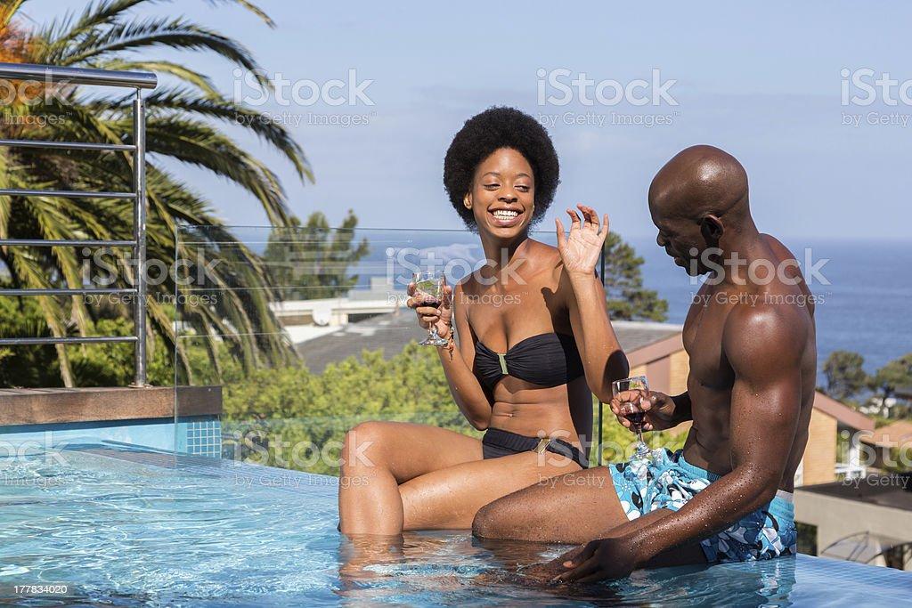 Couple Having Fun by Pool stock photo