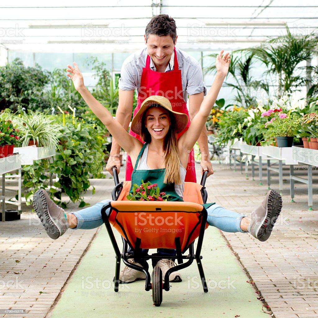 Couple having fun in a Flower Shop stock photo