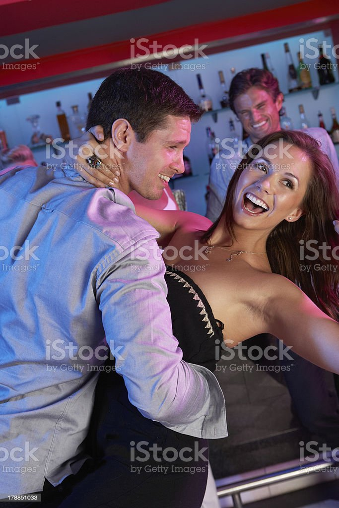 Couple Having Fun In Busy Bar royalty-free stock photo