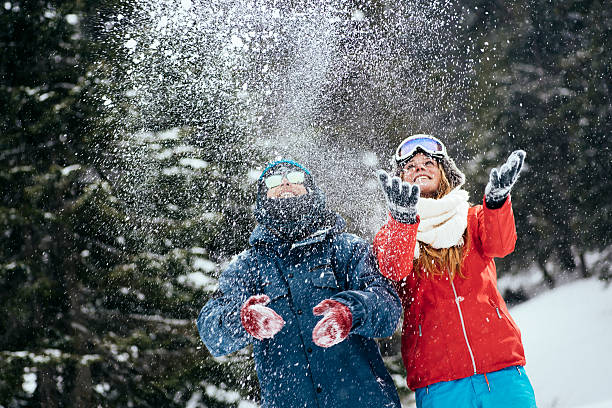 Couple having fun in forest Young couple having fun in forest ski holiday stock pictures, royalty-free photos & images