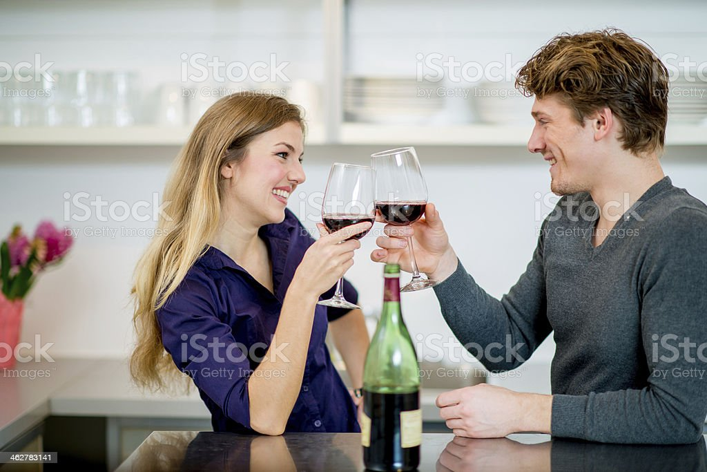 Couple having fun in kitchen royalty-free stock photo