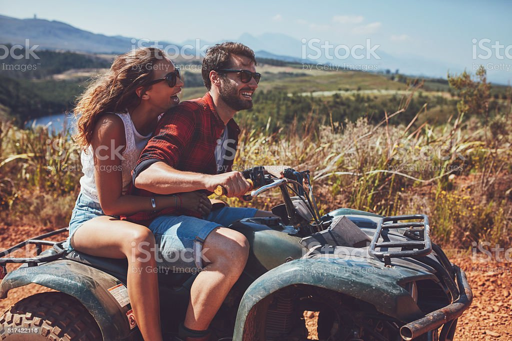 Couple having fun on an off road adventure stock photo