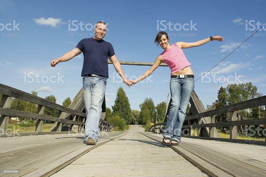 Couple having fun on bridge royalty-free stock photo