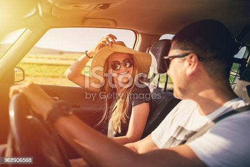 Couple having fun on the road trip through countryside