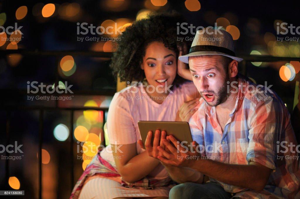 Couple having fun on street stock photo