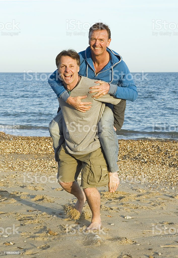 A couple having fun on the beach royalty-free stock photo