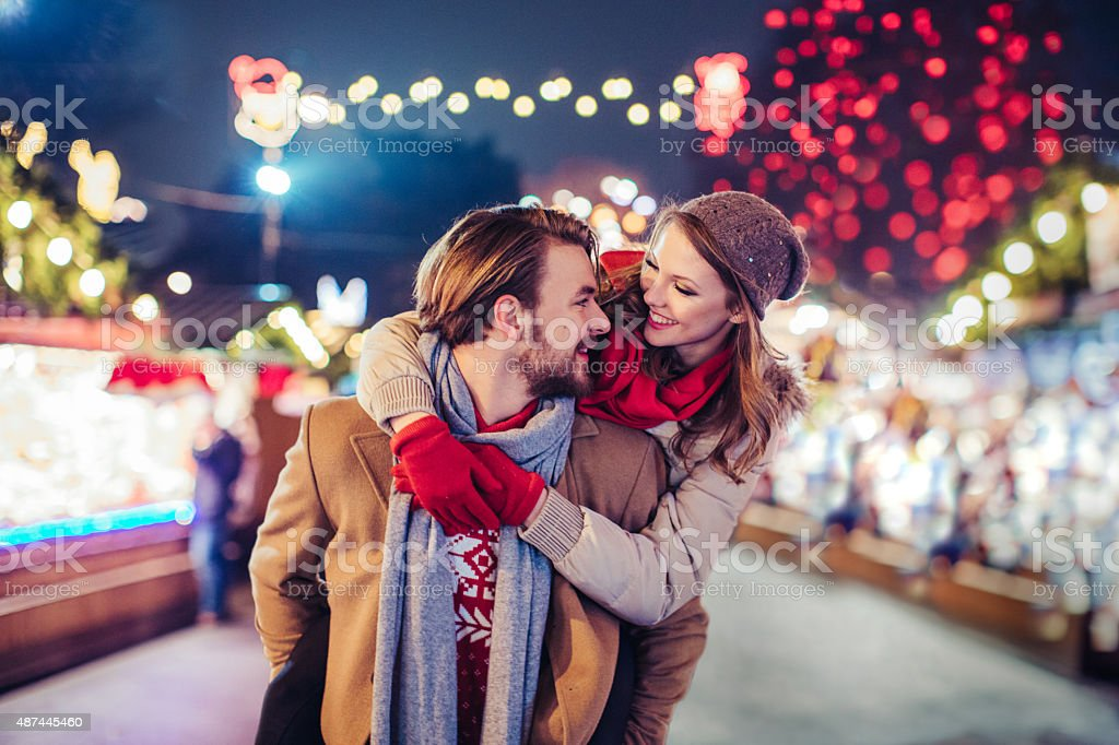 Couple having fun outdoors at winter fair. stock photo