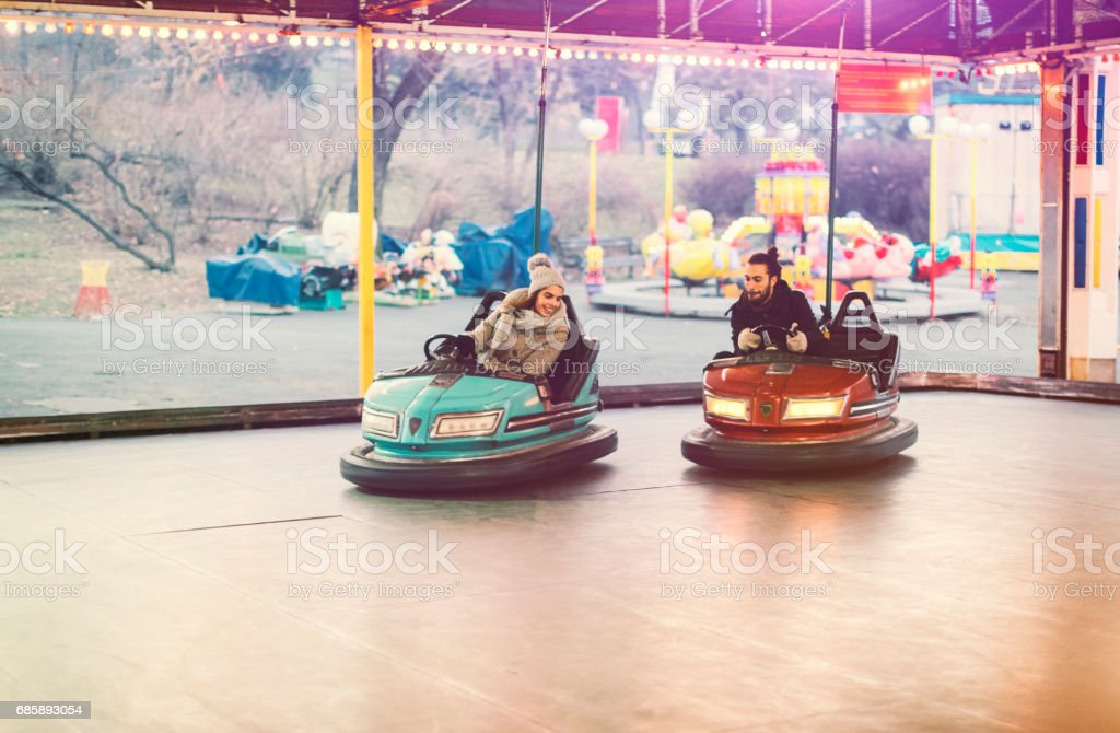 Couple Having Fun Riding Bumper Cars stock photo