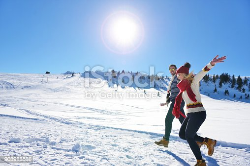 istock Couple having fun running down slope 903988586
