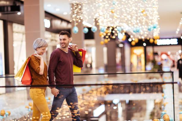 Couple having fun shopping stock photo