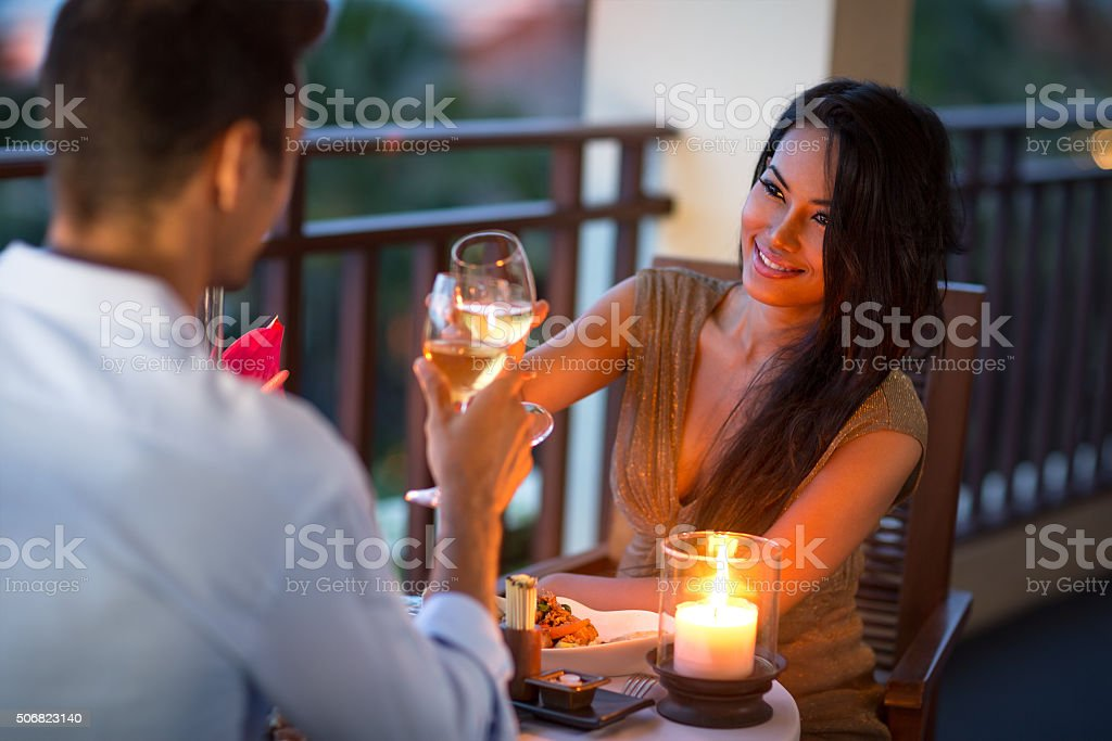Couple having intimate dinner of summer evening stock photo